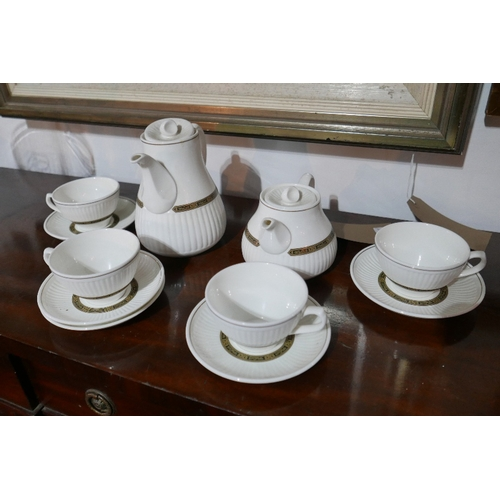 36 - A Wedgwood Insignia part tea set, to include a teapot, hot water pot, four cups and five saucers, (1...