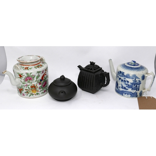 46 - A 19th century Chinese blue and white teapot, together with a famille rose example and with two terr...