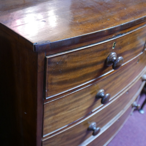 101 - A Georgian mahogany bowfronted chest of two short over three long oak lined drawers on swept feet, H...