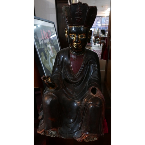 13 - A large 19th century Chinese-Tibetan carved wood and gesso seated figure, possibly depicting the Sav...