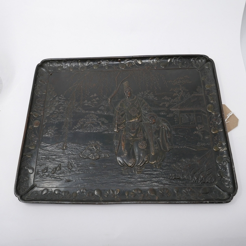 95 - A 19th century Japanese bronzed tray, decorated with figures by a river, within border with fruit an...