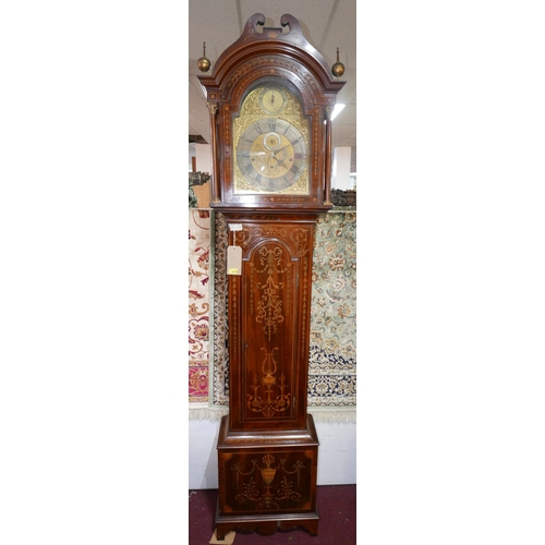 18 - An 18th century mahogany and marquetry inlaid longcase clock, three train movement, eight chiming be...