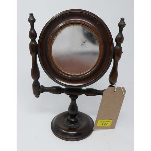 133 - A Victorian turned beech toilet mirror of small size with original concave glass, H.29cm...