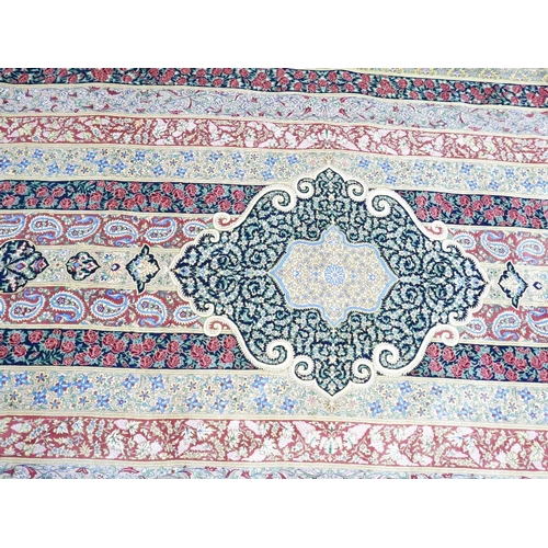 8 - A Persian Qum part silk carpet, signed, with central floral medallion within floral border, fringed,...