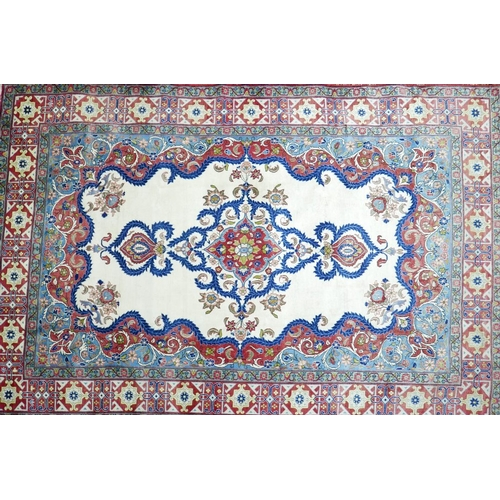 81 - A Central Persian Isfahan carpet, central floral medallion with repeating spandrels on an ivory fiel...