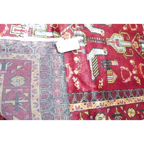 88 - A North East Persian Zabul Belouch rug, repeating bird and petal motifs on a rouge field within styl...