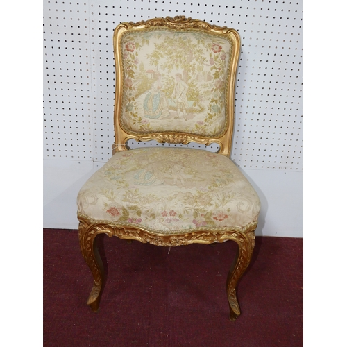 47 - A late 19th / early 20th century Louis XV style side chair, the upholstery decorated with figures an...