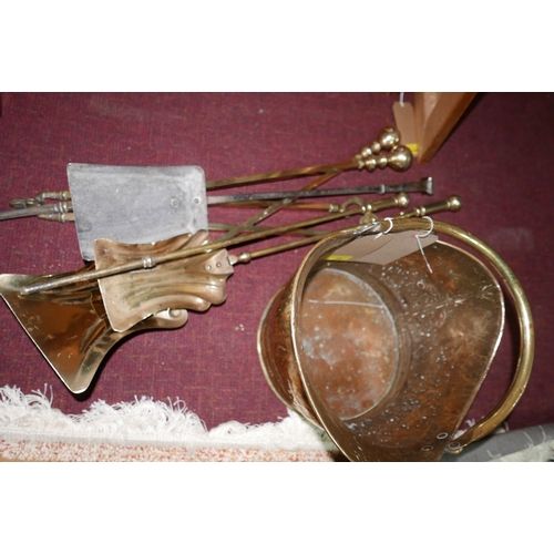 19 - A 19th century brass 'helmet' scuttle, with a selection of fire arms, (6)...