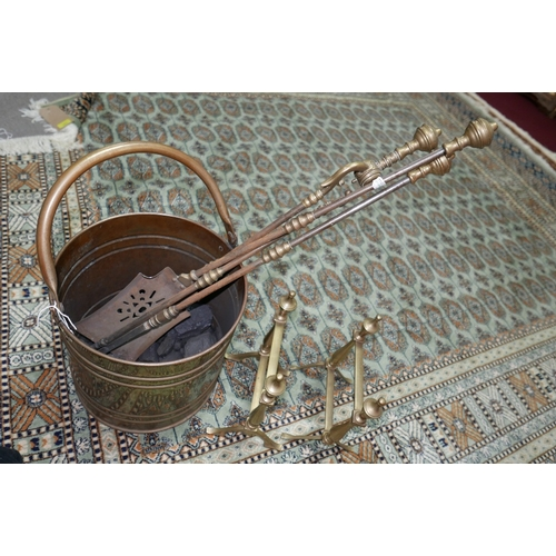 28 - A 19th century brass coal scuttle, together with fire arms and stands...