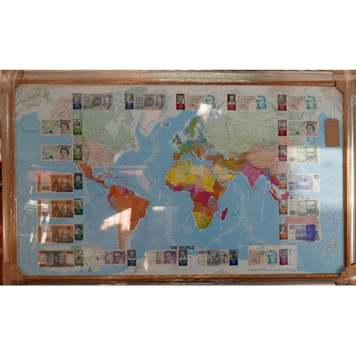7 - A sporting interest, a map of the world mounted with international currency signed by famous footbal...