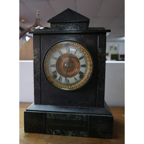 145 - A late Victorian slate and marble mantel clock, H.33cm...