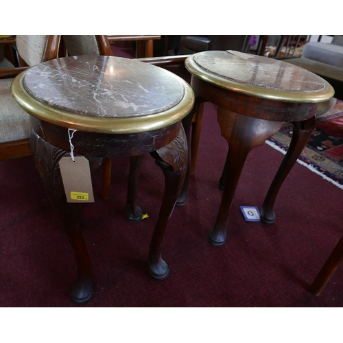 223 - A pair of oval marble topped low tables with brass bound edges on carved mahogany cabriole supports...