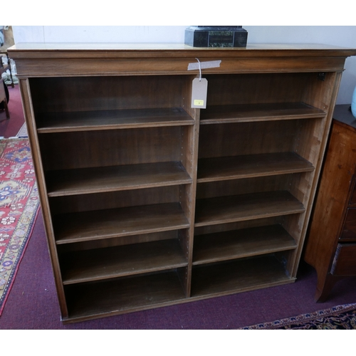 3 - A large early 20th century walnut open bookcase with plinth top and arranged over 10 shelves, 133.5 ...