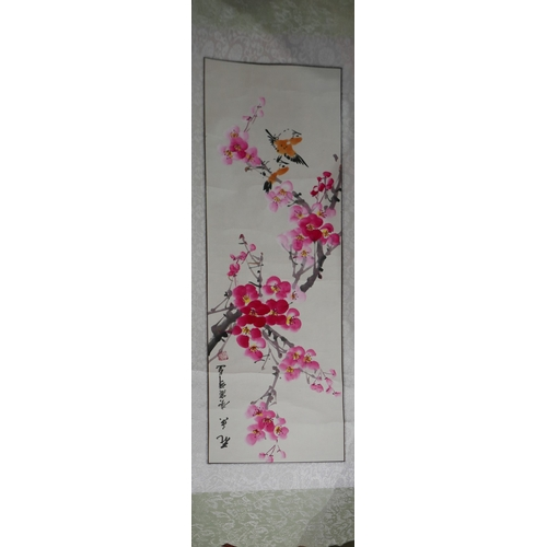 58 - A Chinese wall hanging scroll depicting horses togther with another of bamboo, and a print of blosso...