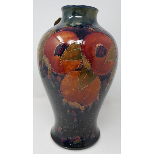 60 - An early William Moorcroft vase, with pomegranate design, signed in paint to base with impressed mar...