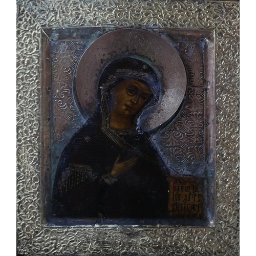 14 - A Russian icon of the Mother of God, tempera on wood panel, with brass and white metal oklad with ve...