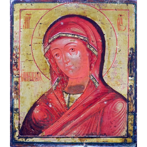21 - A Russian icon of a female saint, tempera on wood panel with gilt background, with velvet cover to v...
