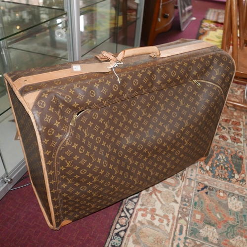 72 - A large sized Louis Vuitton holdall style suitcase with side zip opening H.57 L.79cm...