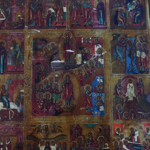 8 - A Russian icon depicting the Descent into Hell, the Resurrection and the Feasts, tempera on wood pan...