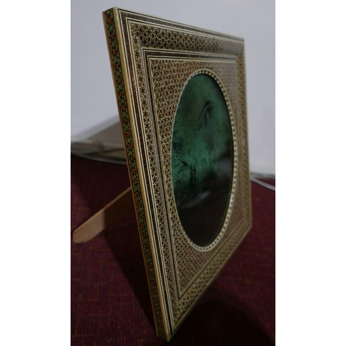 42 - A large Persian photograph frame inlaid and handpainted with small stars and geometric forms, (green...