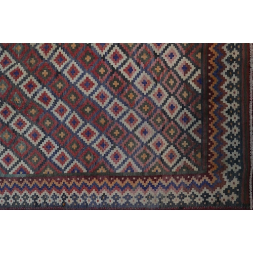 66 - A South West Persian Qashqai kilim, repeating stylised geometric motifs on a terracotta field within...