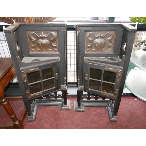 310 - A pair of Arts and Crafts ebonized corner cabinets, inset with copper panels, H.93 W.50 D.30cm...