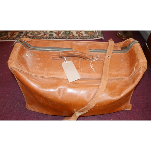 81 - A vintage calf skin holdall, monogrammed S.A.M. L.68cm and another similar with Facconable label....