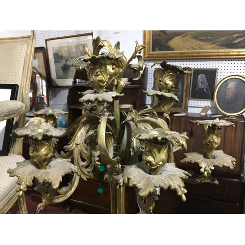 56 - A 19th century ormolu 9 branch candelabra engraved Abbotts to base, H.83cm...
