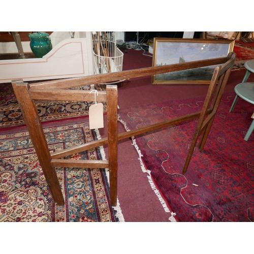 200 - A late 19th/ early 20th century oak folding towel rail, H.84 W.130 D.41cm...