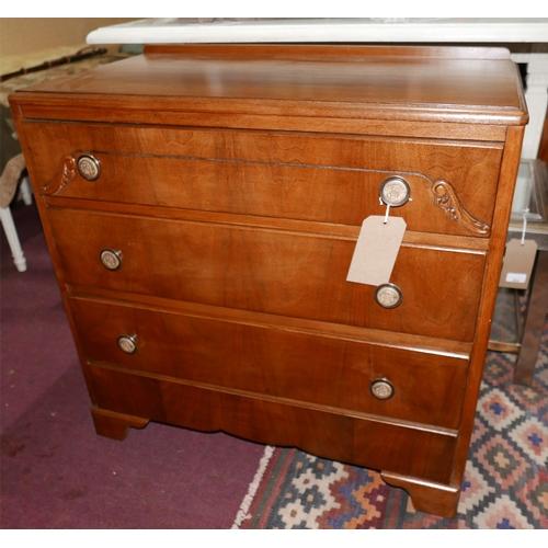 180 - An early 20th century walnut chest of three drawers, raised on bracket feet, H.77 W.74 D.41cm...