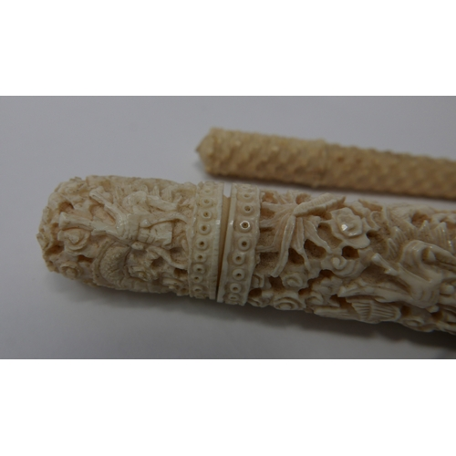 21 - A 19th Chinese carved ivory stick etui of cylindrical form, with dragons, phoenix, bats and foliage,...