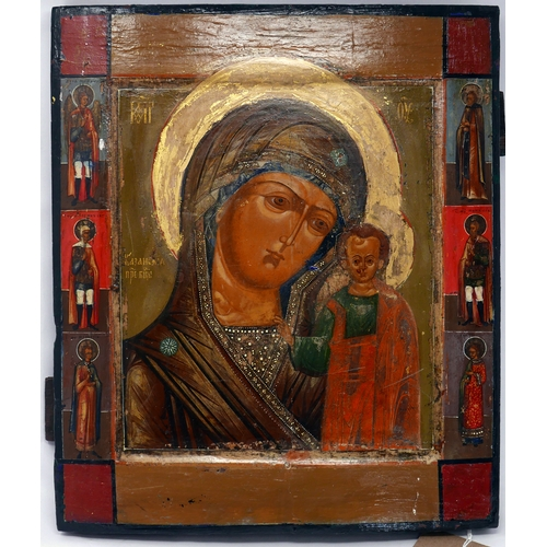 3 - A Russian icon of the Mother of God of Kazan with selected saints to border, tempera on wood panel, ...