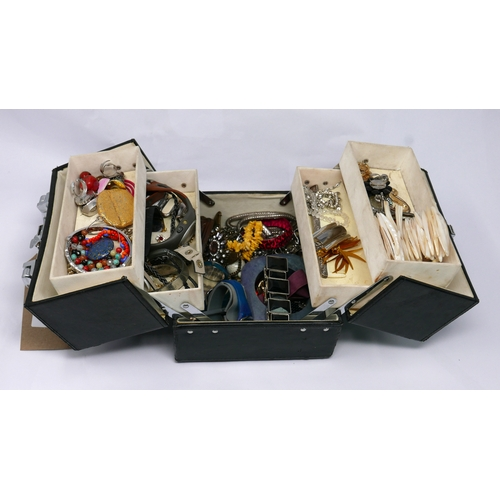 50 - A black leather jewellery box containing a variety of costume jewellery to include earrings, necklac...