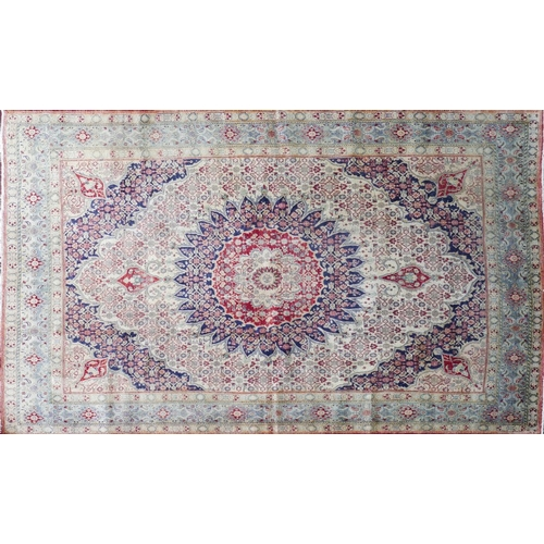 101 - A North East Persian Moud carpet, central double pendent medallion with repeating Heratie motfis on ...