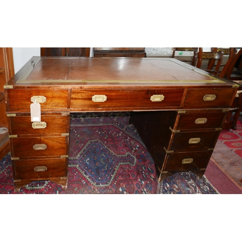 131 - A Georgian style mahogany architects campaign pedestal desk with rising tooled leather centre sectio...