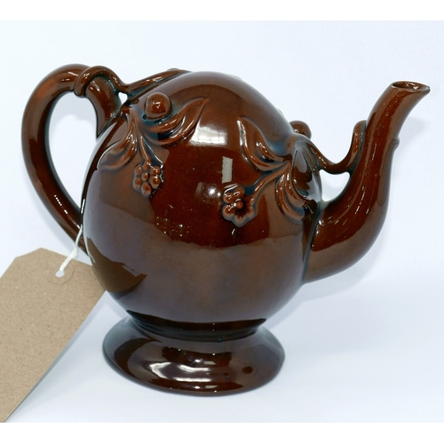 74 - A Copeland Cadogan Trelle glazed teapot, decorated with foliage, marked to base, H.16.5cm, small chi...