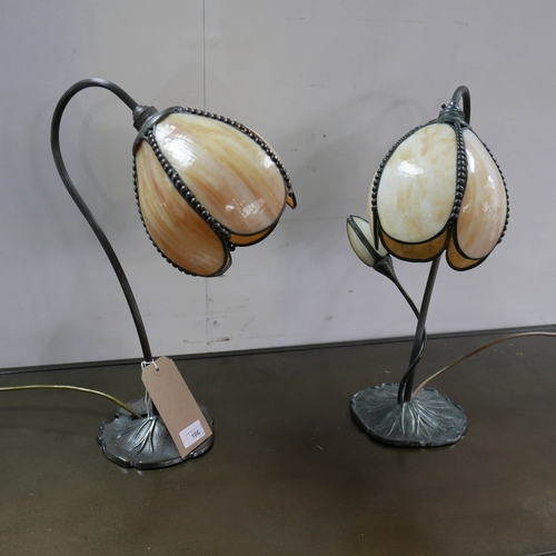 106 - Two of Art Nouveau style table lamps, with floral shades on lily pad moulded base, one having two li...