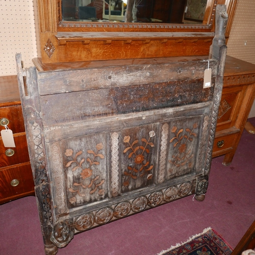 145 - A 17th/18th century carved oak bed head with marquetry inlay, 144 x 124cm (needs restoration)...