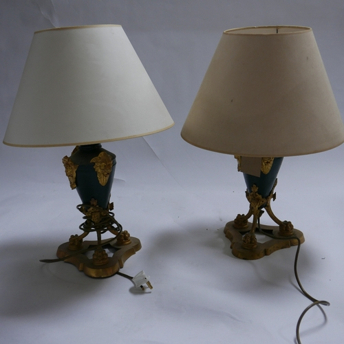 221 - A pair of Empire style gilt metal table lamps, H.50cm...