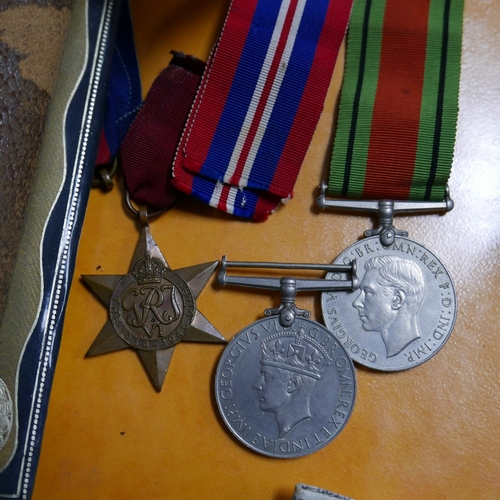 27 - A group of four WWII medals together with driving licenses, letters and photographs for a Sgt Archie...