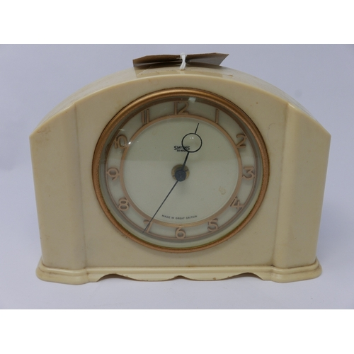80 - A vintage, Smiths, '30 hour' clock in a stepped cream plastic case, the circular dial and gilded Ara...