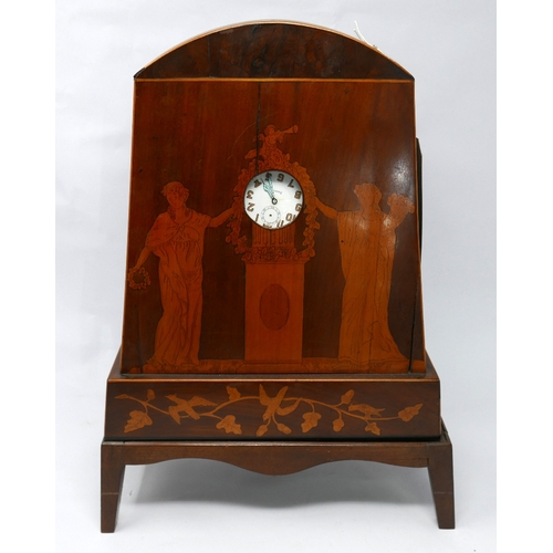 13 - A mahogany and marquetry inlaid watch stand in the form of an arched mantel clock, inlaid with Class...
