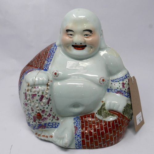 18 - A late 19th century Chinese Republic porcelain model of a seated Buddha, H.26cm (badly restored)...