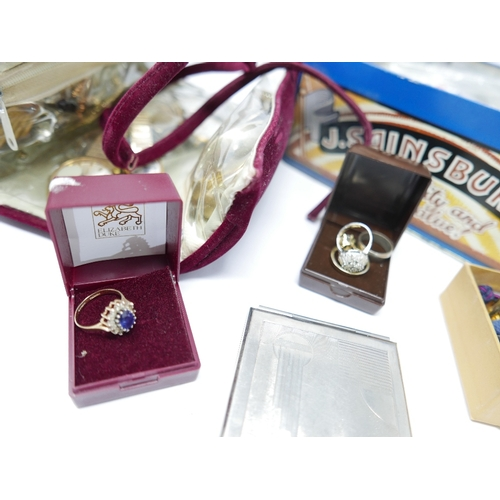 33 - A large collection of vintage costume jewellery to include a 9ct yellow gold ring set with a central...