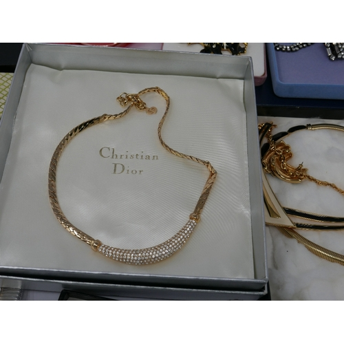 41 - A collection of boxed vintage costume jewellery to include Christian Dior, Monet, Pierre cardin, etc...