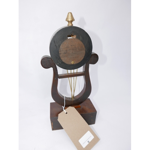 5 - A mahogany and brass mounted harp shaped watch stand, on rectangular block base, with brass floral p...