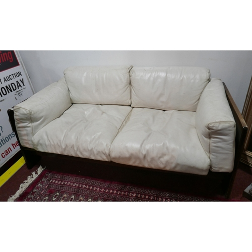 184 - A 1970's white leather sofa by Tobia Scarpa in teak frame. L.150 H.54 D.76cm...