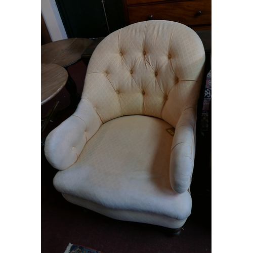 24 - A 19th century mahogany armchair in the manner of Howard & Sons, in button backed apricot woven upho...