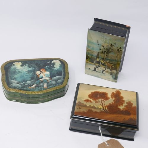 37 - Three Russian hand-painted lacquer boxes, comprising one depicting a riverscape, signed and no. 3183...