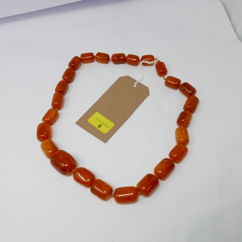 8 - A large, baltic natural amber bead necklace composed of twenty-five, graduated beads of polished, cy...